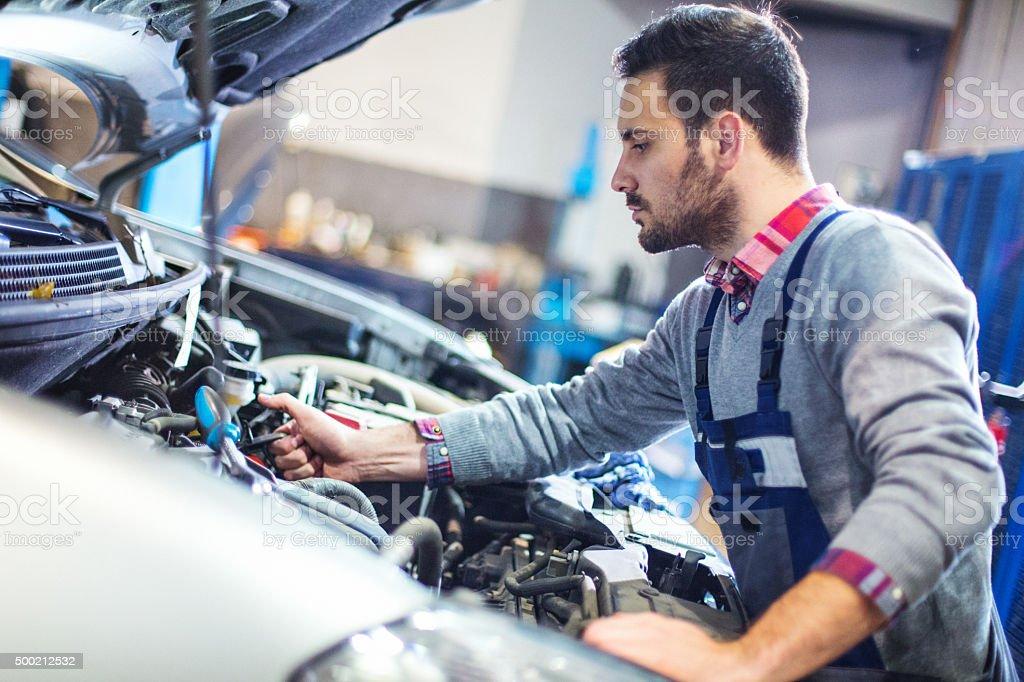 Car mechanic repair an engine. stock photo