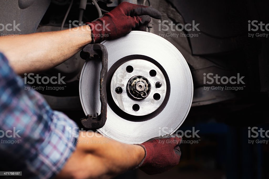 Car mechanic Repairing brakes stock photo