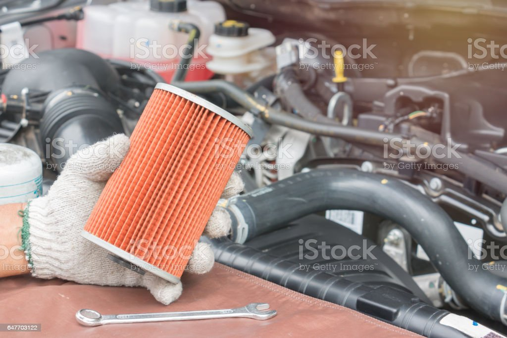 Car mechanic replace the fuel filter stock photo