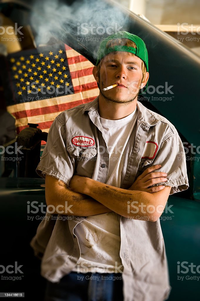 Car Mechanic Smoking Cigarette Environmental Portrait royalty-free stock photo