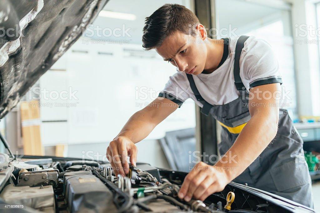 Car Mechanic Working in Workshop stock photo