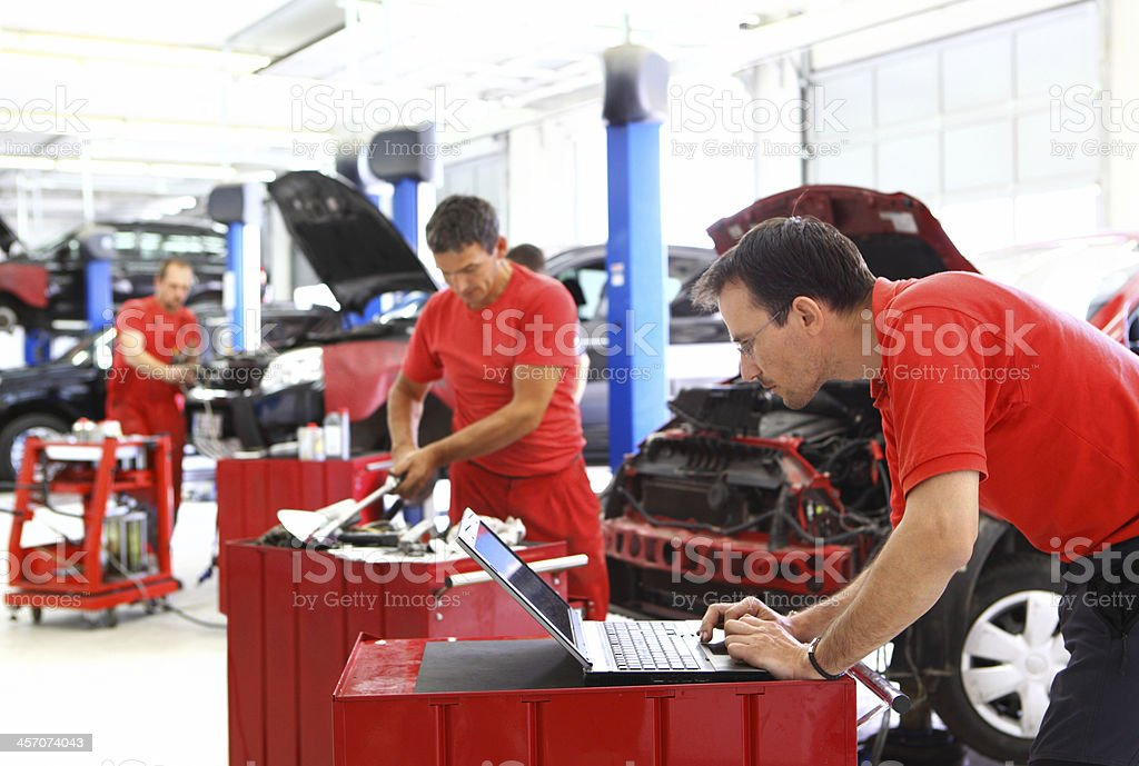 Car mechanics at work. stock photo