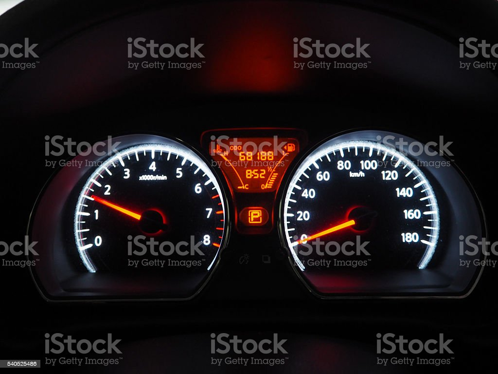 Car mileage monitor in the dark stock photo