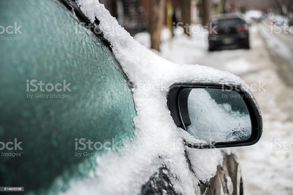 Car mirror and windows after freezing rain stock photo
