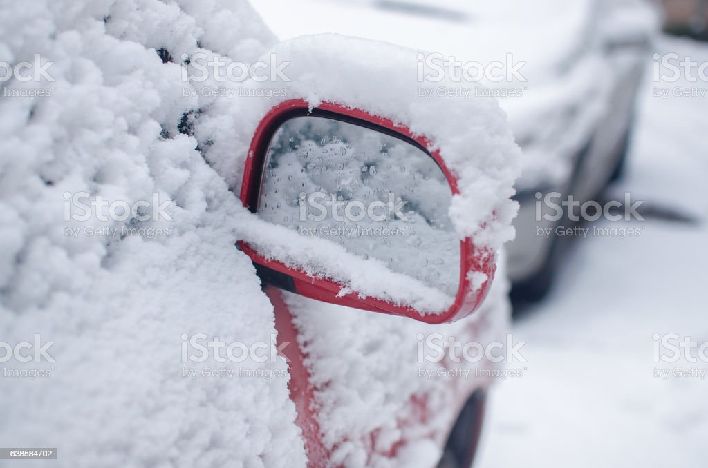 Car mirror filled snow in winter season stock photo