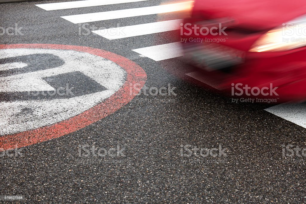 Car moving across the pedestrian stock photo