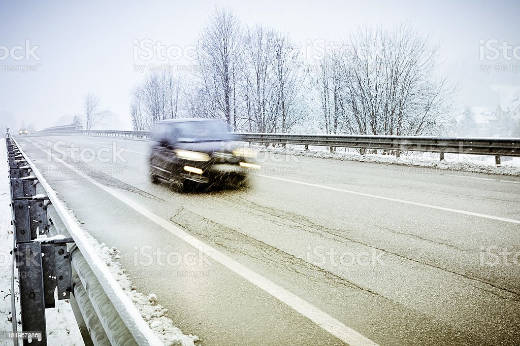 Car moving fast during a snowfall royalty-free stock photo