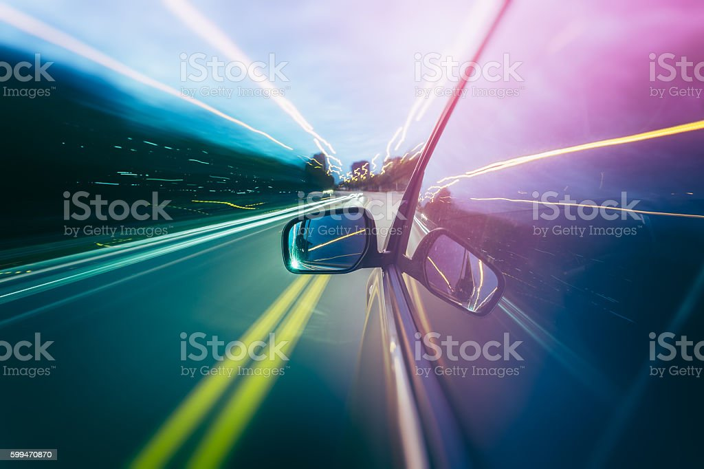 Car moving fast with light trails stock photo