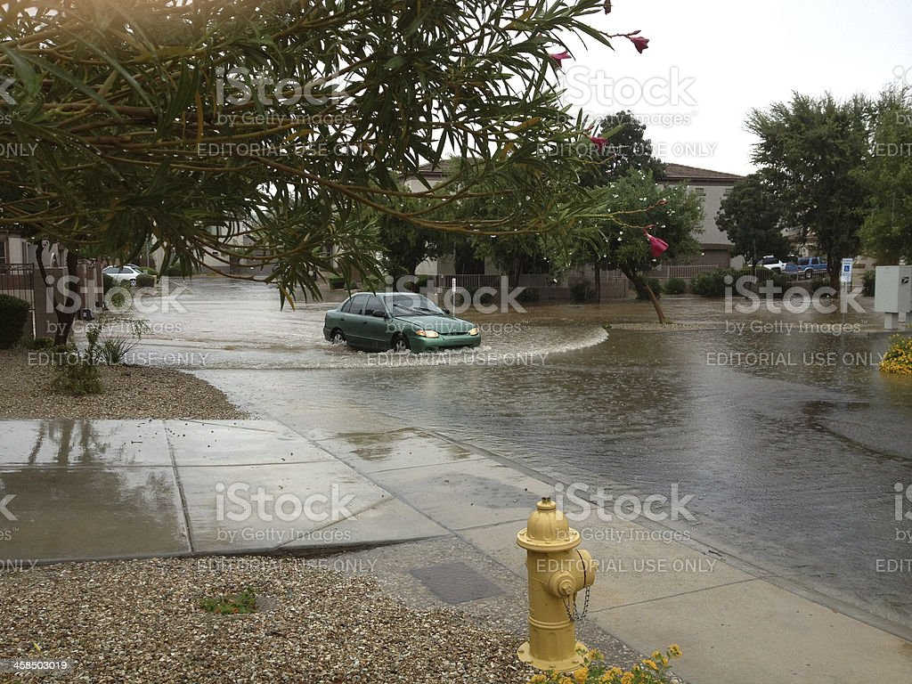 Car moving thru flooded area royalty-free stock photo