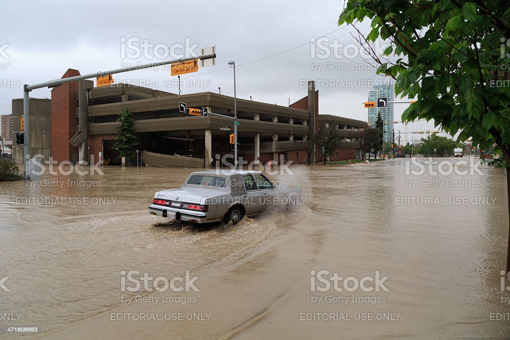Car Navigates a flooded 3rd street during Calgary Flooding royalty-free stock photo