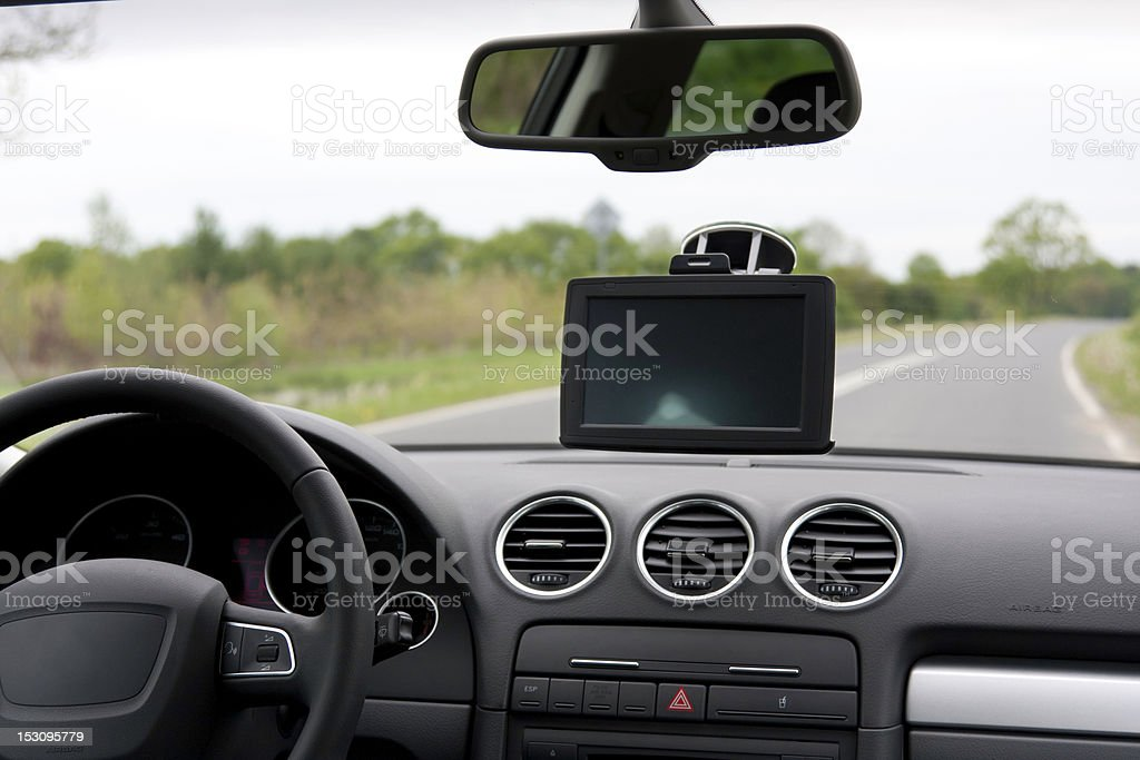 car navigation system (GPS) mounted in car on windshield royalty-free stock photo