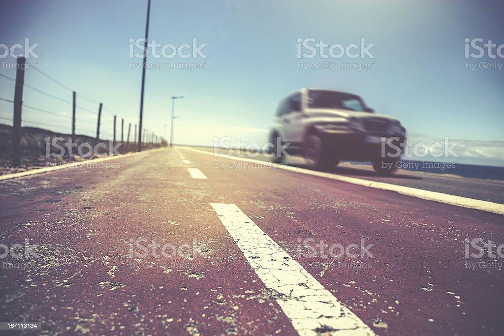 Car on a coastal road stock photo