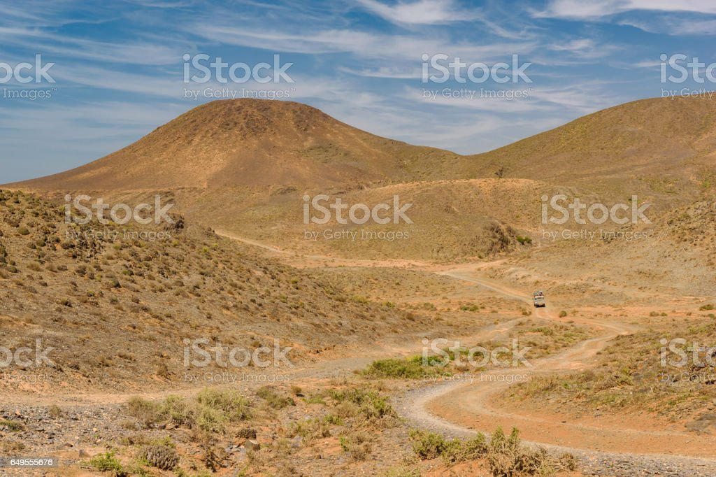 Car on a dirt road, Guelmim-Es Semara, Morocco stock photo