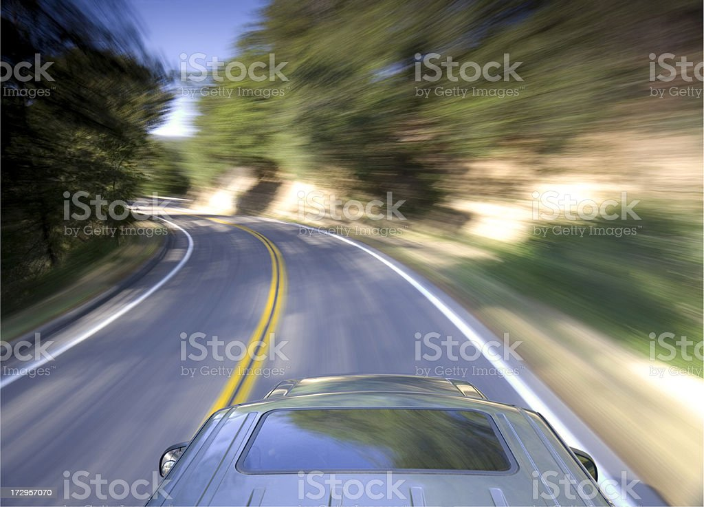 car on a winding road royalty-free stock photo