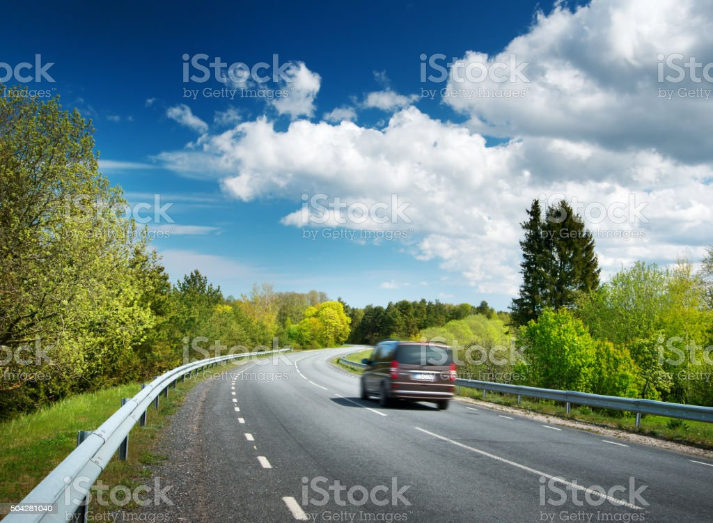 Car on asphalt road in beautiful spring day stock photo