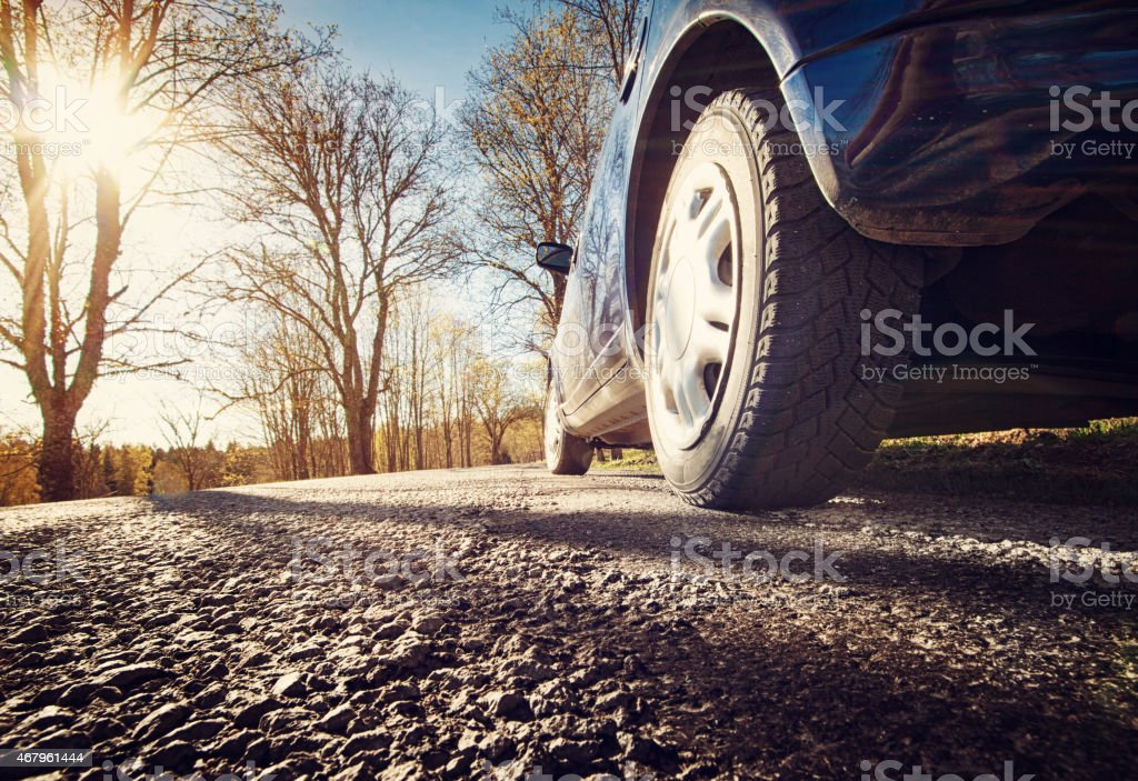 Car on asphalt road in spring morning stock photo