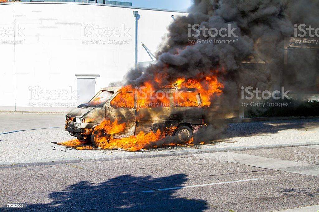 Car on fire stock photo