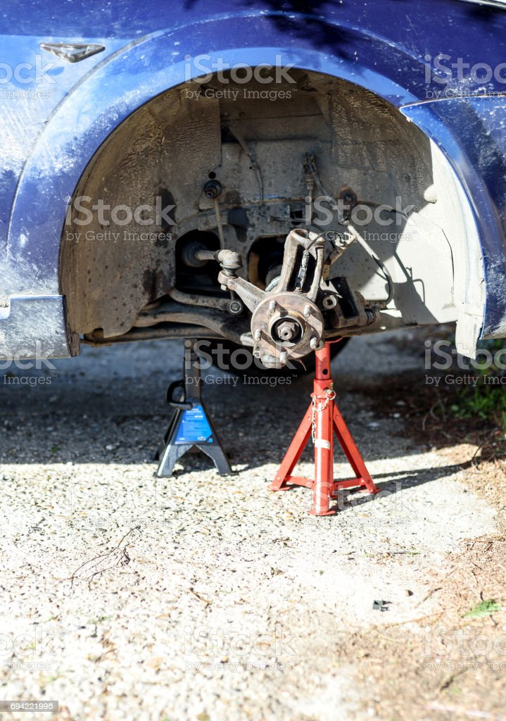 Car on Jack with No Tyre stock photo