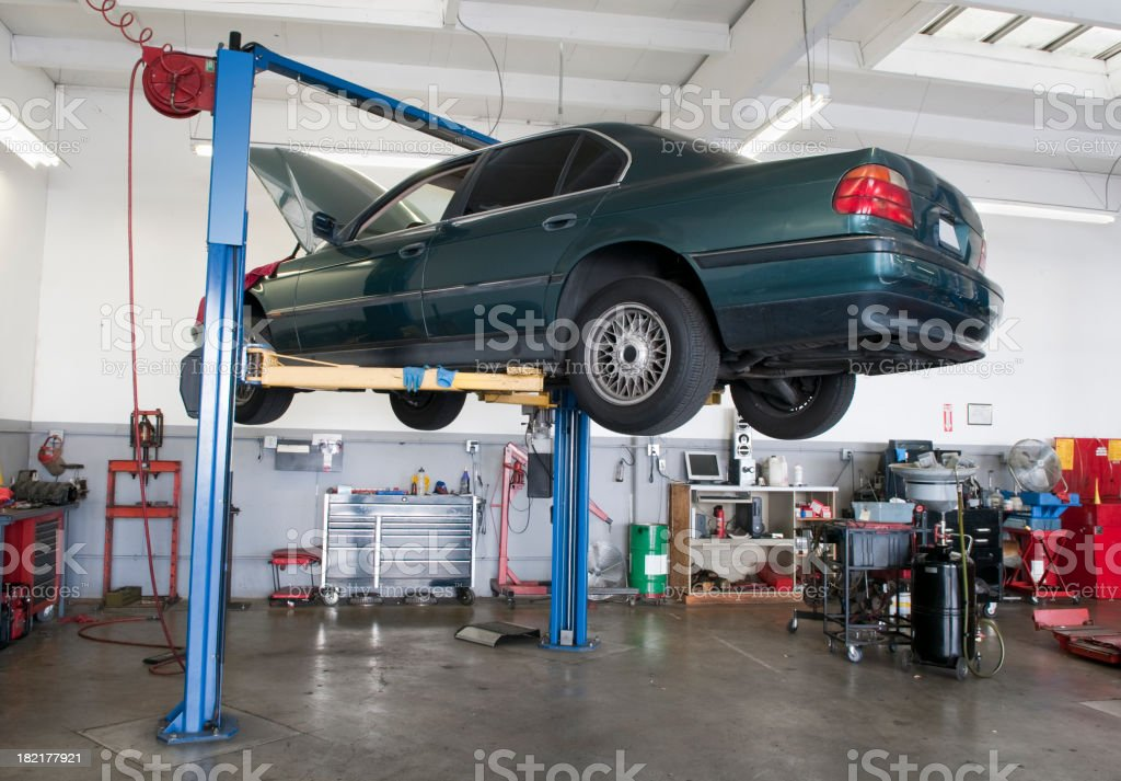 Car on Lift in Auto Repair Garage stock photo