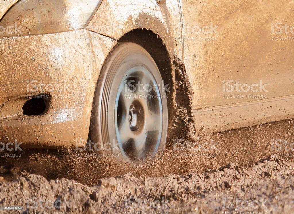 car on muddy road stock photo