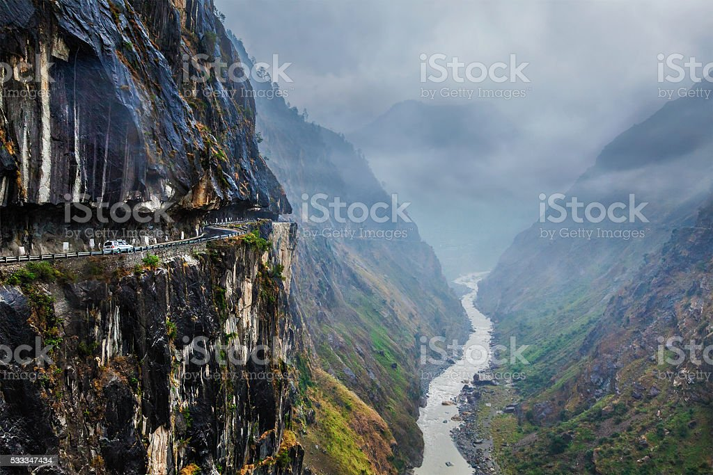 Car on road in Himalayas stock photo
