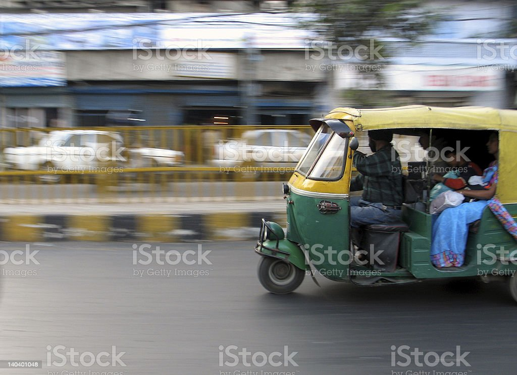 Car on the move down the street royalty-free stock photo
