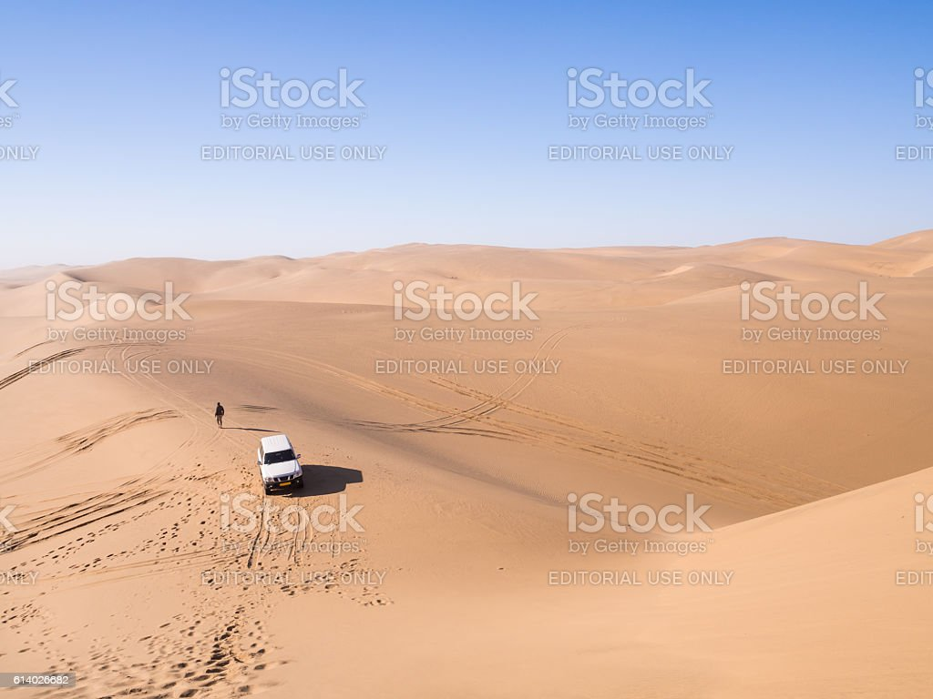 Car on the Namib Desert in Sandwich Harbour, Namibia stock photo
