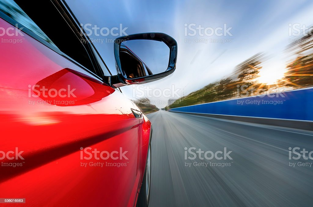 car on the road with motion blur background. stock photo