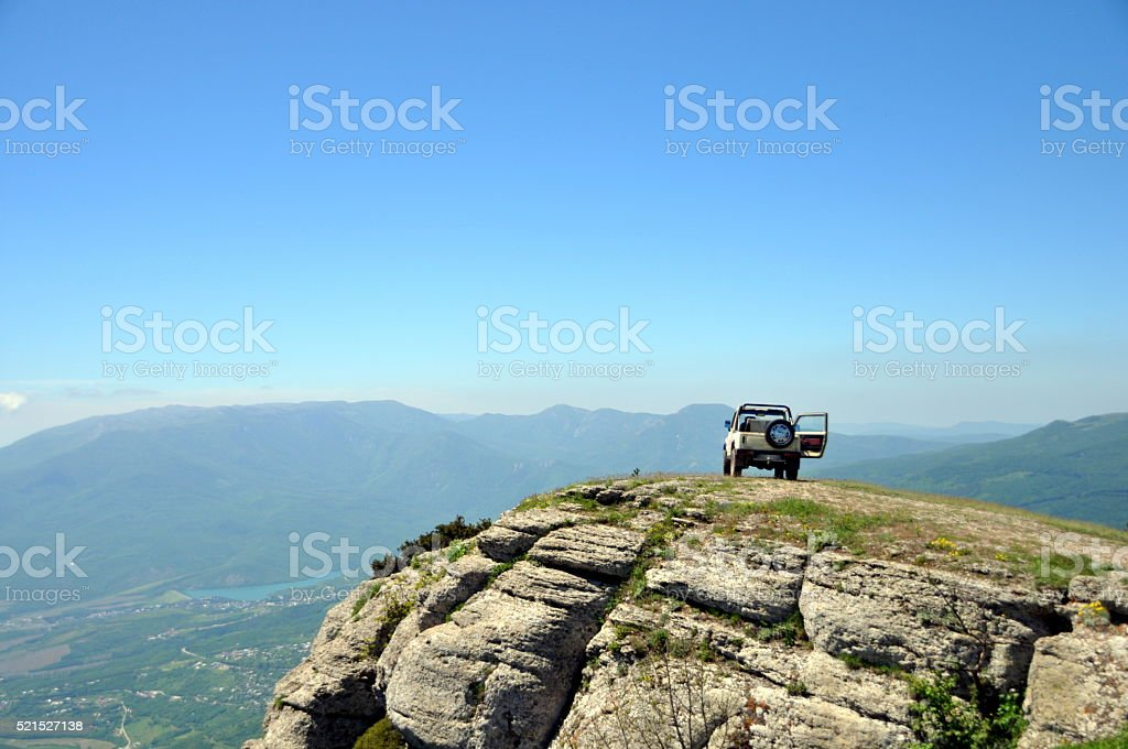 car on top of the mountain stock photo