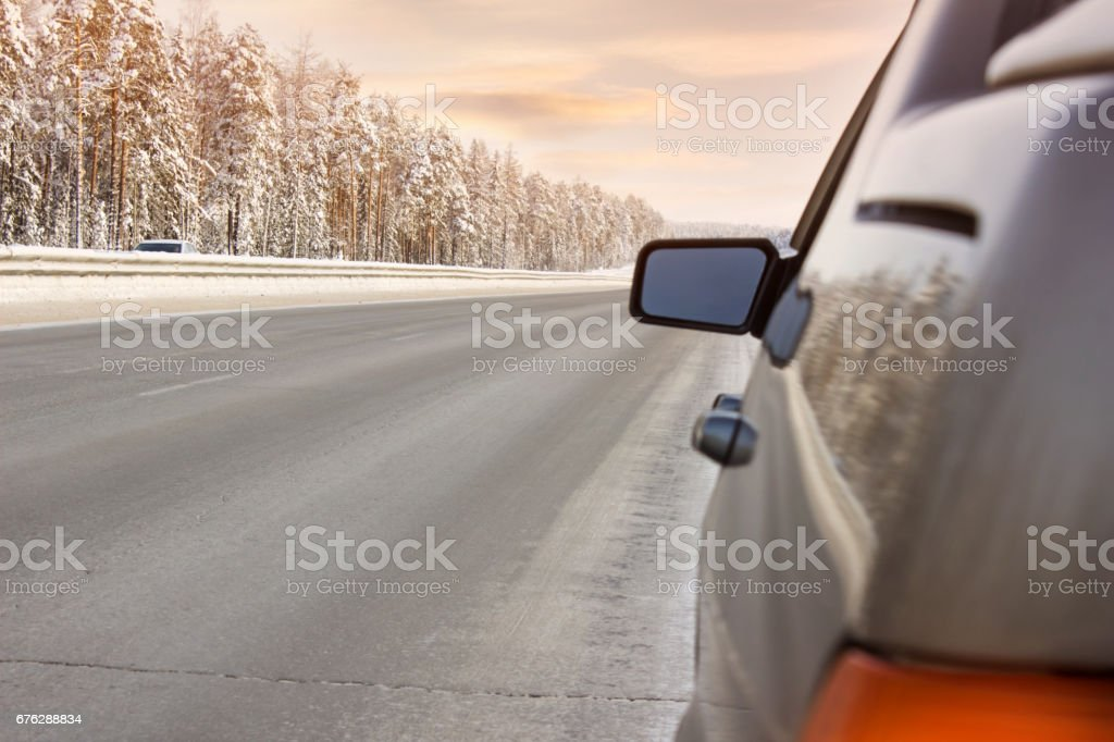 Car on winter road, bright and clear weather stock photo