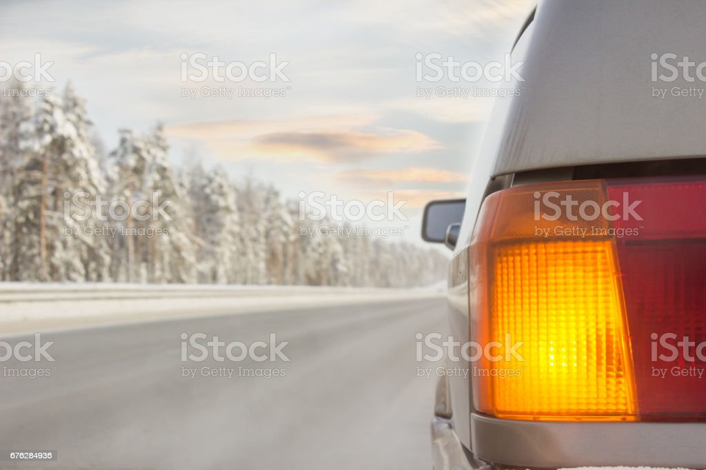 Car on winter road included emergency signals stock photo