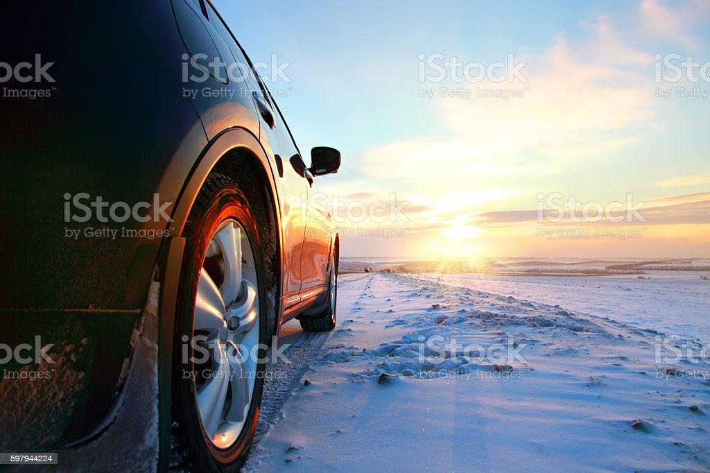 Car on winter road stock photo