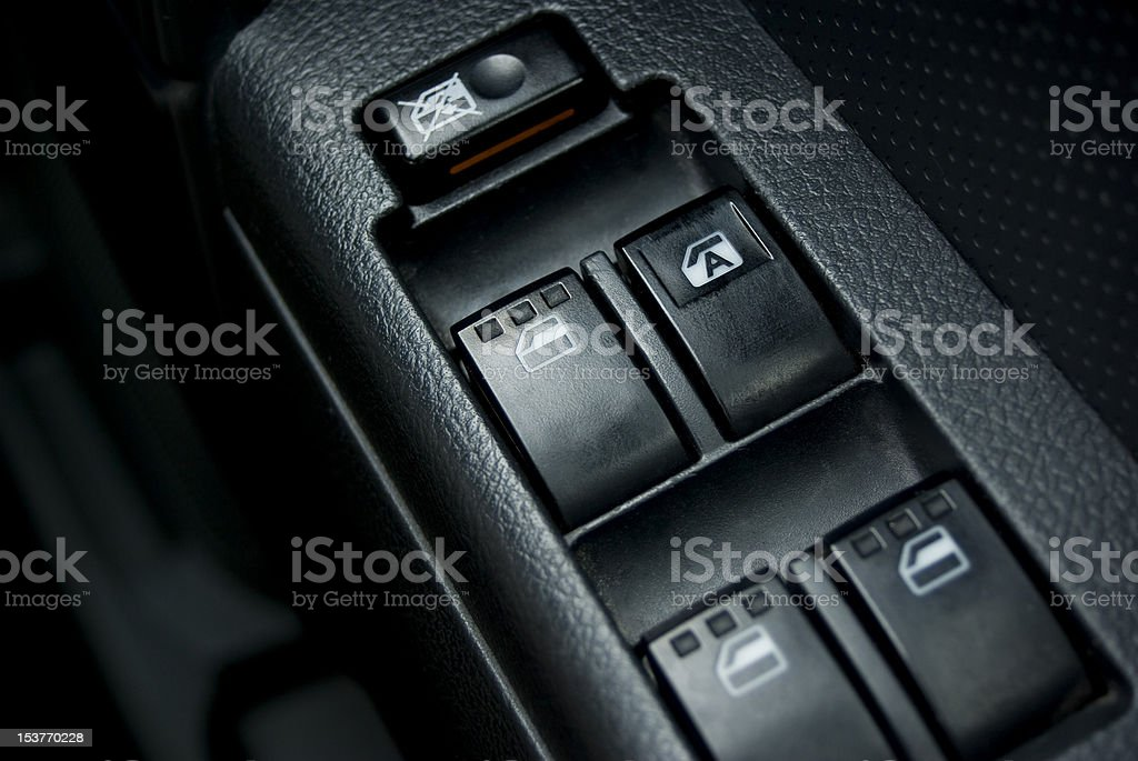 car or vehicle interior; power window switch close up stock photo
