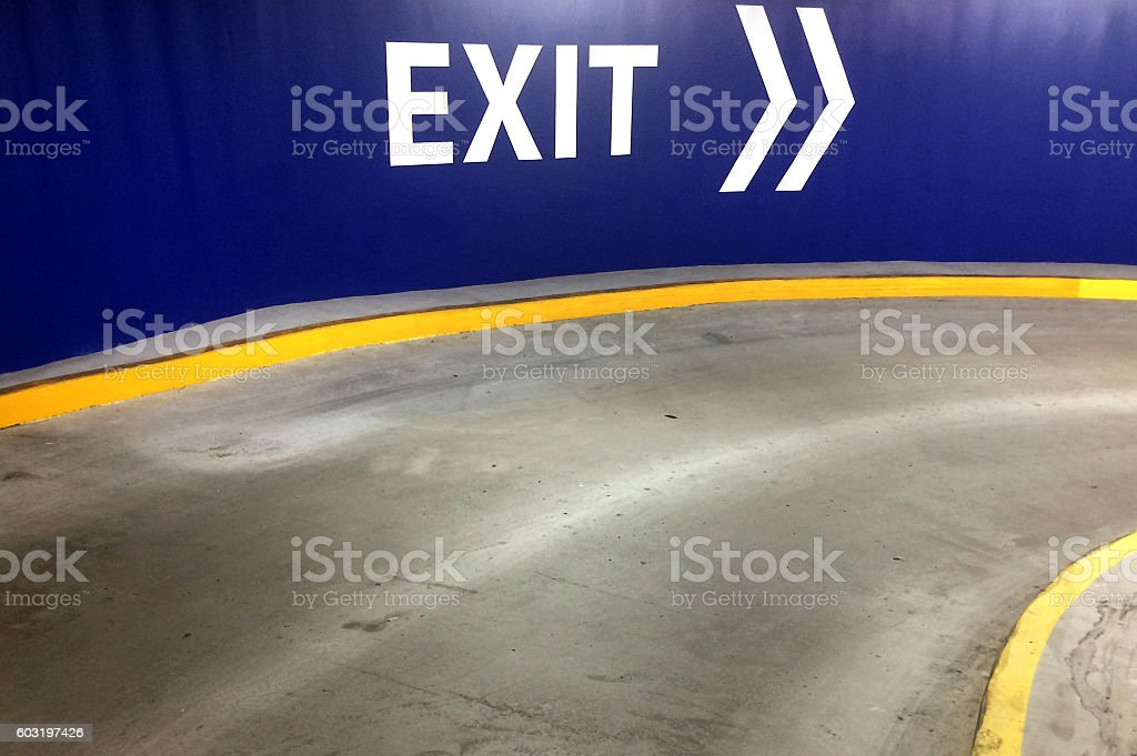Car park exit sign with directional arrow stock photo