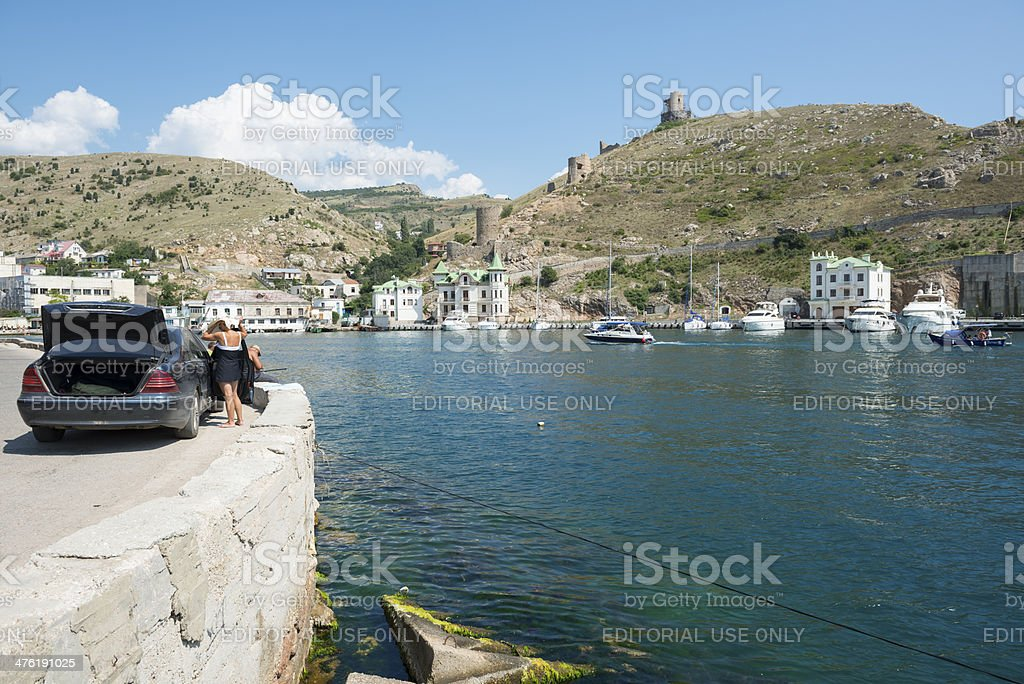 Car parked beside the harbor in Balaklava, Crimea stock photo