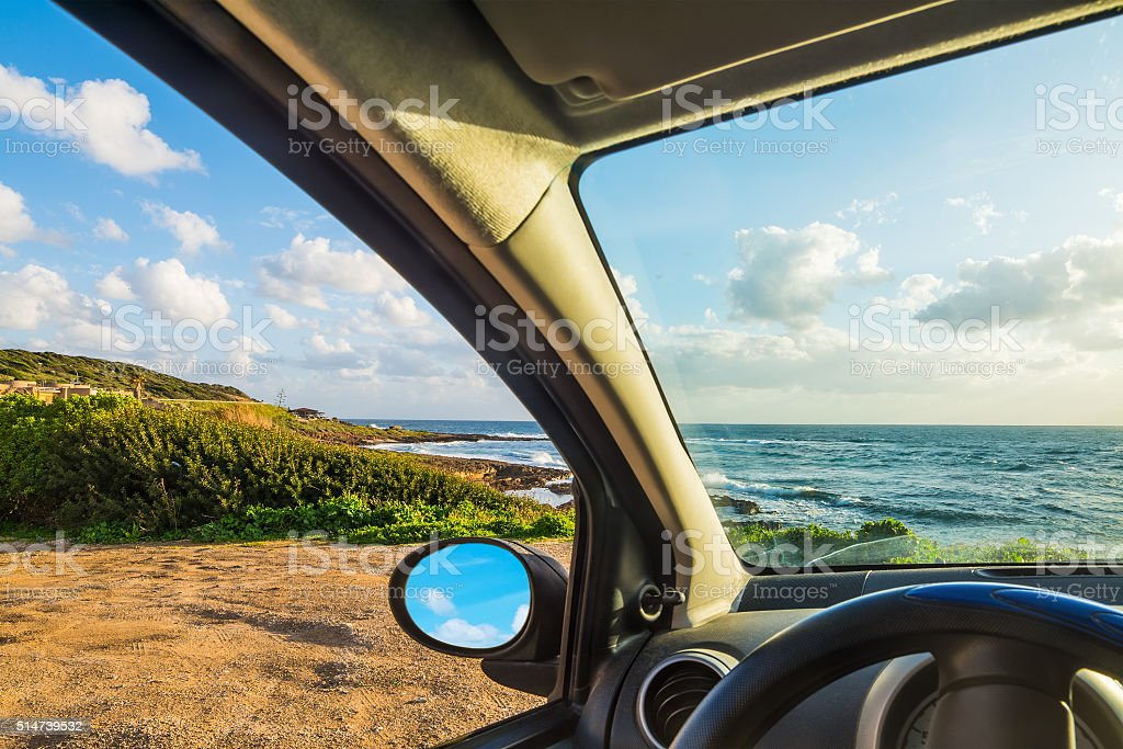 Car parked by the sea stock photo