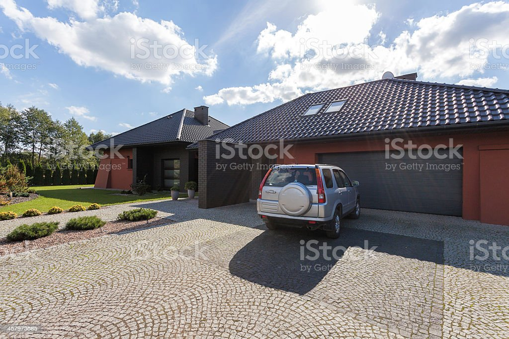 Car parked in front of a house stock photo
