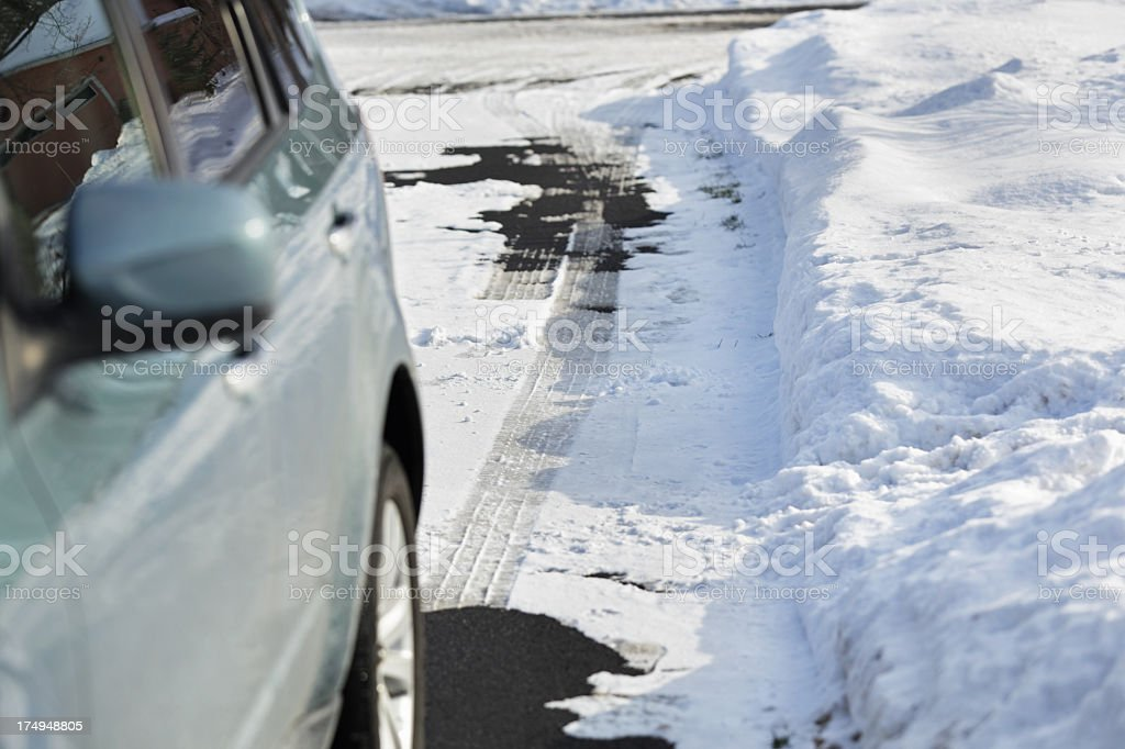 Car Parked in Winter Driveway stock photo