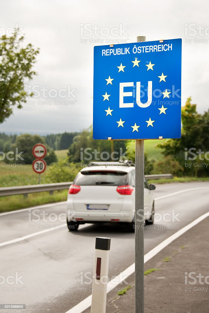 Car passing a EU (European Union) border post stock photo