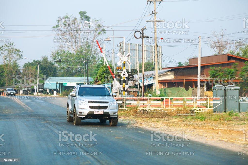 Car passing railway crossing in Kanchanaburi stock photo