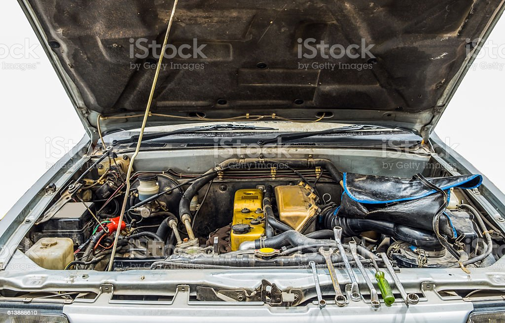 Car pick up old open engine with repair tools stock photo