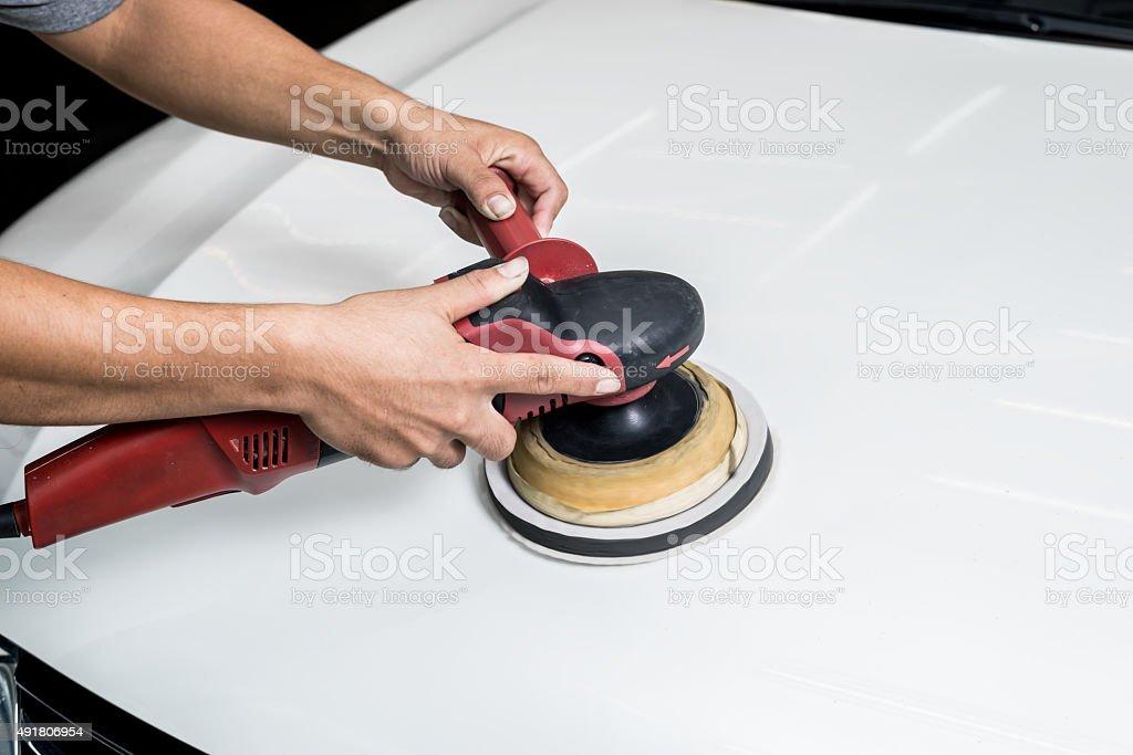 Car polishing series : Worker polishing white car stock photo