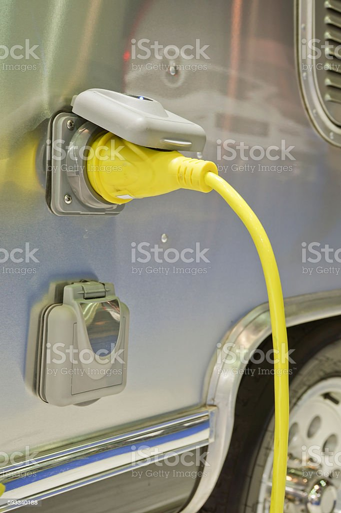 Car Power Plug in to electric car. stock photo