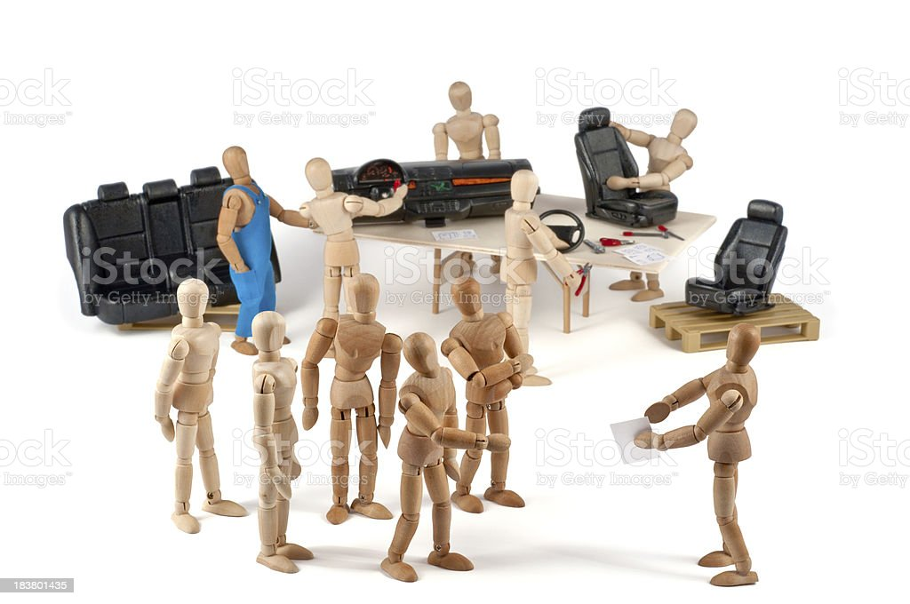 Car production - wooden mannequin team stock photo