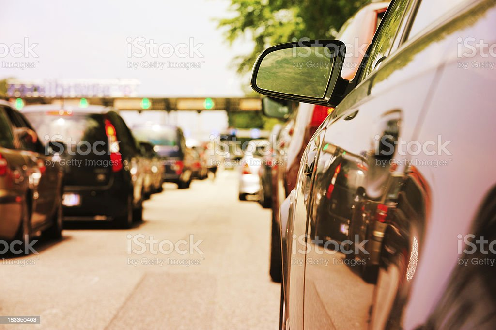 Car queue. Waiting to pass road toll royalty-free stock photo