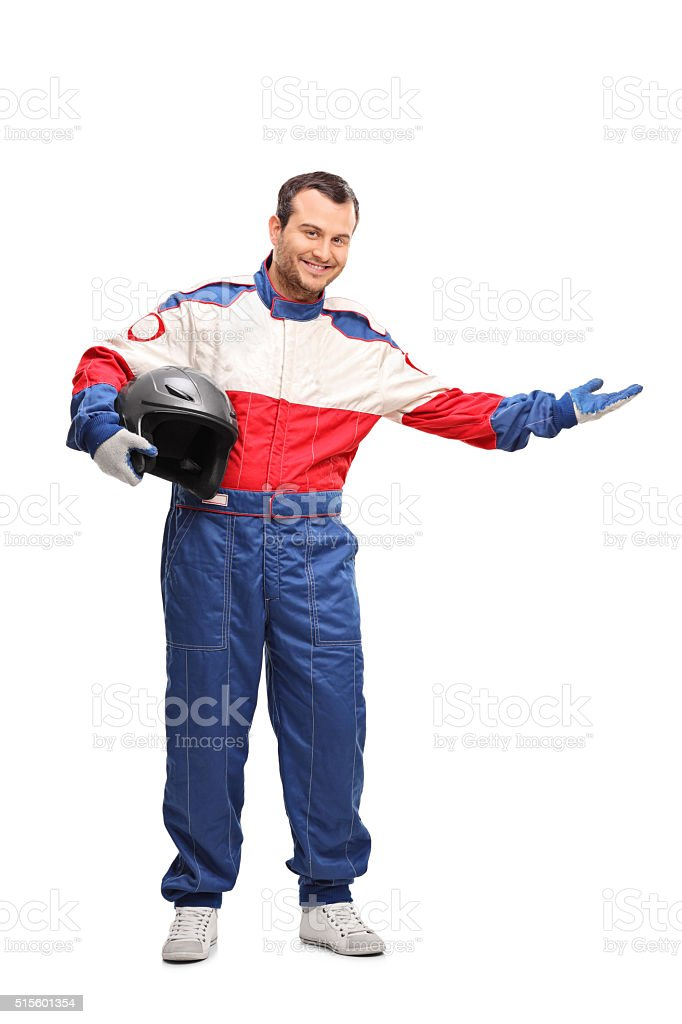 Car racer holding a helmet and gesturing stock photo