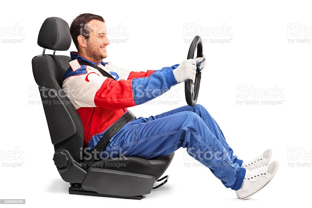 Car racer holding a steering wheel and driving stock photo