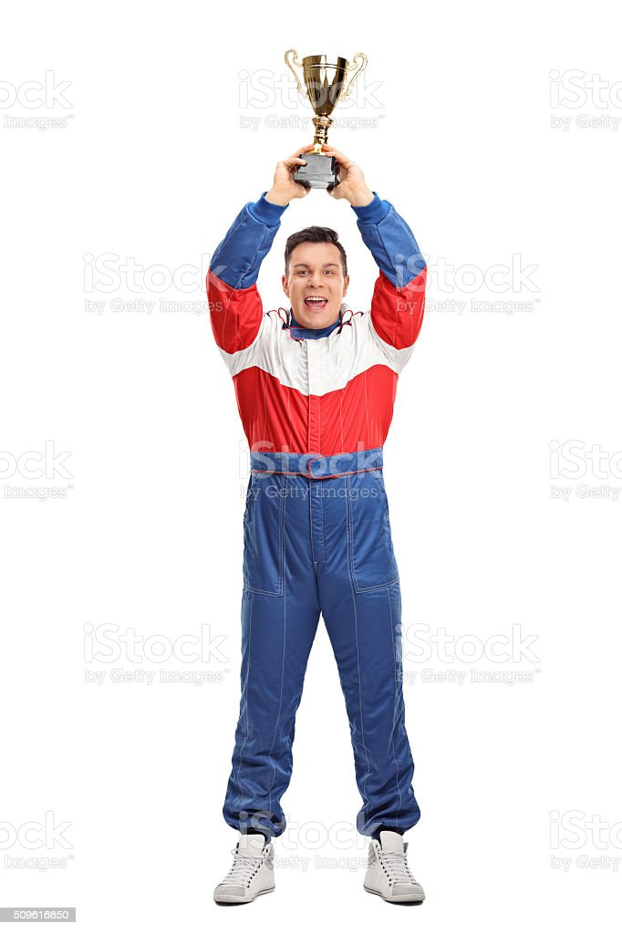 Car racing champion holding a trophy stock photo