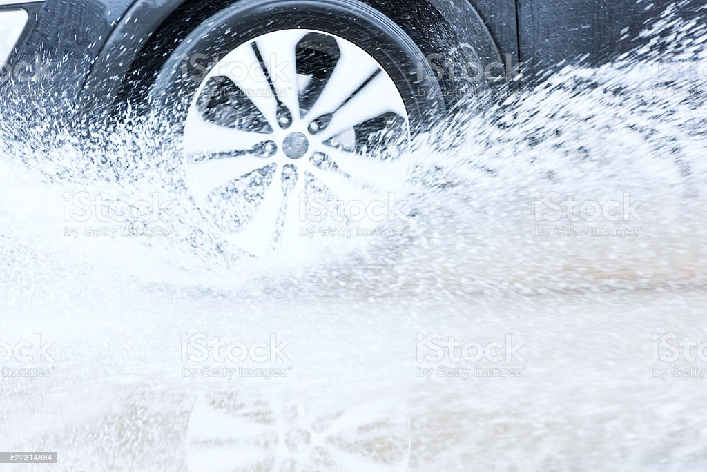 car rain puddle splashing water stock photo