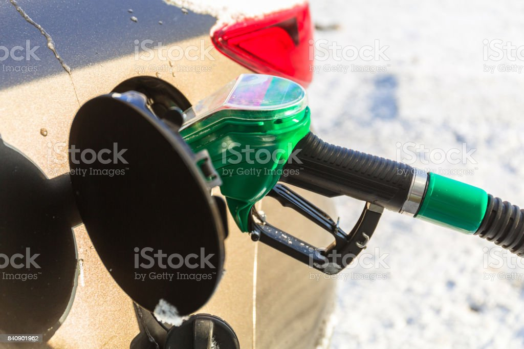 Car refill with petrol on the gas station stock photo